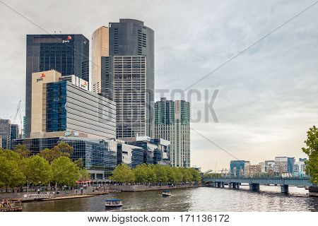 Melbourne Australia - December 27 2016: Melbourne city view with people traveling on boats along the Yarra river Victoria