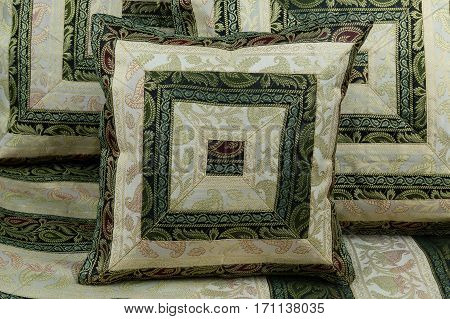linens and pillows on a black background