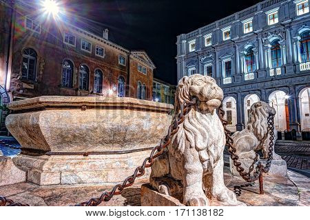 Piazza Vecchia, Citta Alta, Bergamo, Italy. Night view on the square with the beautiful fountain in the center of the square illuminated by night lights.