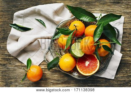 Fresh citrus fruits with leaves top view