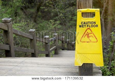 Warning sign for wet floor in the outdoor