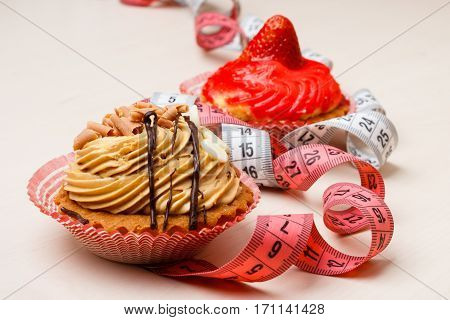 Cupcakes With Measuring Tapes On Table