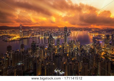 Victoria peak victoria harbor Hongkong city Kowloon city and building view with sunrise Hong kong China