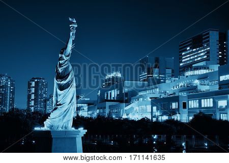 TOKYO, JAPAN - MAY 15: Statue of Liberty with modern buildings on May 15, 2013 in Tokyo. Tokyo is the capital of Japan and the most populous metropolitan area in the world