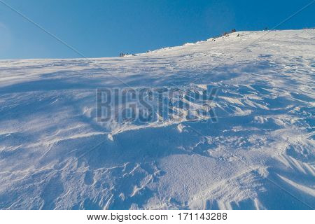 Windy snow in a sunny day on the snow slope