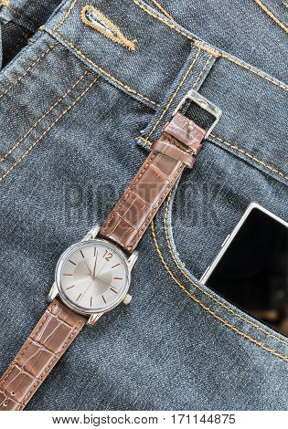 Wrist Watch And Smartphone On Jeans