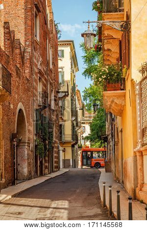 Vintage ancient street with old houses in Veneto region. Verona town. Italy