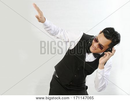Young Asian Dj Boy In A Suit.