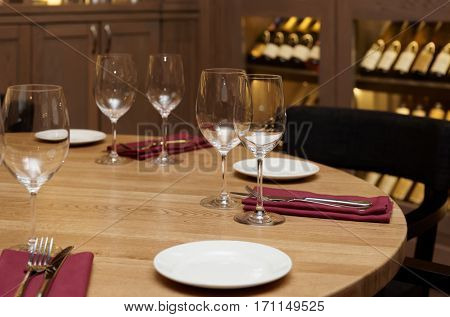 Restaurant table with wine refrigerator in blurred background