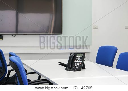 IP phone on table in boardroom for conference meeting