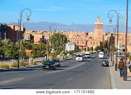 Ouarzazate Morocco - Jan 4 2017: View on street and mosque. Ouarzazate area is film-making location where Morocco's biggest studios