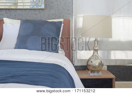 Blue Bedding Style And Classic Style White Reading Lamp In Bedroom