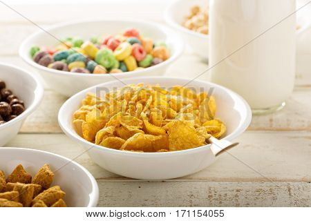 Cornflake cereals in a bowl with milk in a bottle