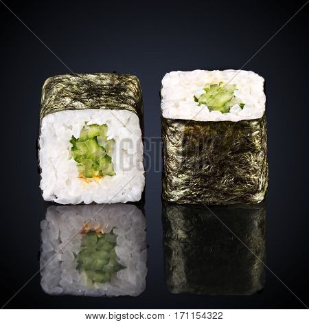 Kappa maki rolls with cucumber on the black background