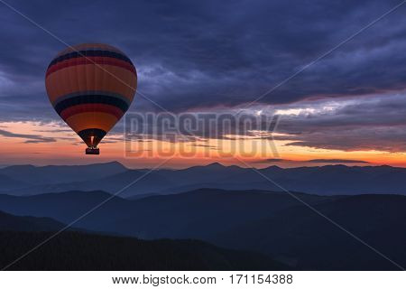 Balloon silhouette in the sunrise sky