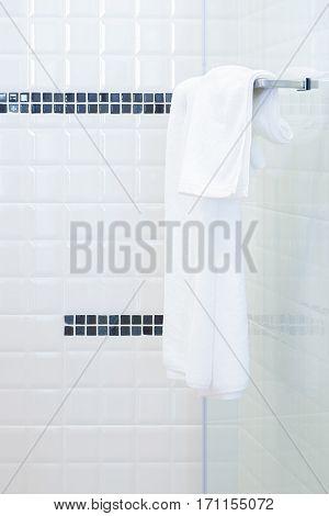 White towel hanging on towel rail in modern restroom