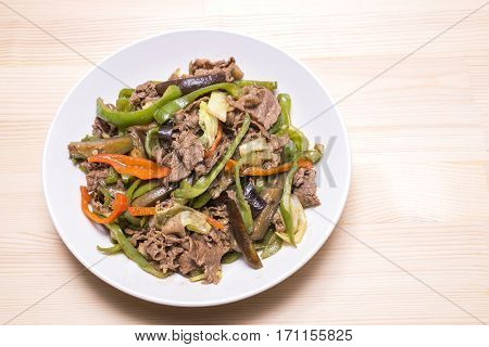 Sauteed beef meat and various vegetables on a plate