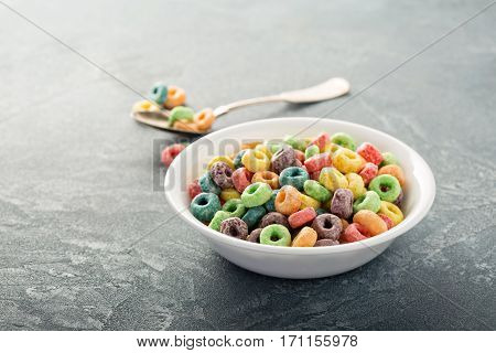 Fruit colorful sweet cereals in a bowl, traditional quick breakfast or snack for kids