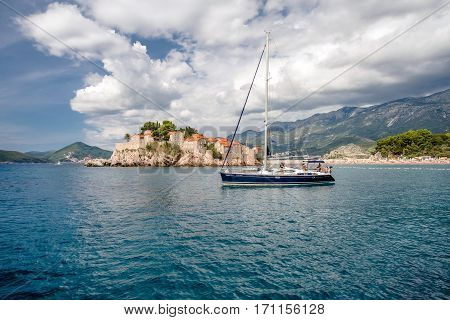 Sveti Stefan, MONTENEGRO - SEPTEMBER 22, 2016:Tourists sailing on a yacht near the island of Sveti Stefan, Montenegro.