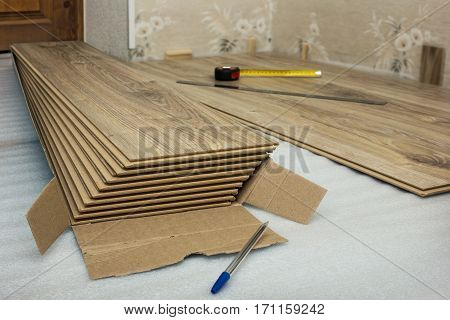 A few pieces in the package of laminated panels simulating oak