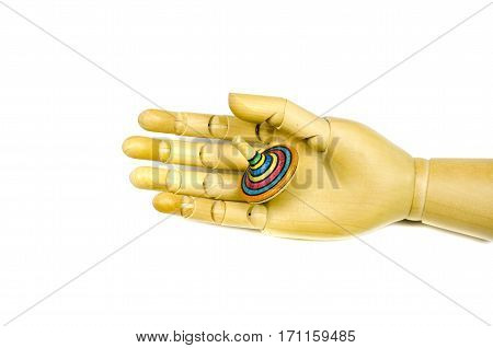 artist manikin hand holding wooden toy spin whirligig isolated on white