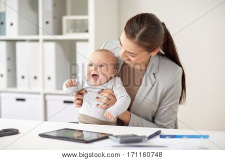 business, motherhood, multi-tasking, family and people concept - happy smiling businesswoman with baby working at office