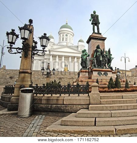 HELSINKI, FINLAND - april, 4, 2016: St. Nicholas Church and a monument of Alexander II on the Senatorial area in Helsinki, Finland.