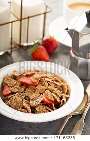 Multigrain wholewheat healthy cereals with fresh strawberryfor breakfast