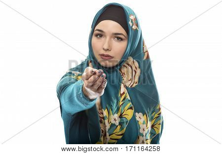 Female wearing a hijab conservative fashion for muslims middle east and eastern european culture. She is isolated on a white background and pointing forward
