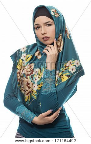 Female wearing a hijab conservative fashion for muslims middle east and eastern european culture. She is isolated on a white background and looking worried of failure