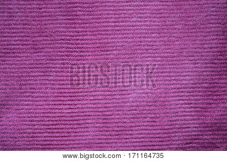 textile and texture concept - close up of purple velveteen fabric background