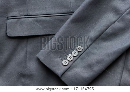 clothing, formal wear, fashion and objects concept - close up of business suit jacket