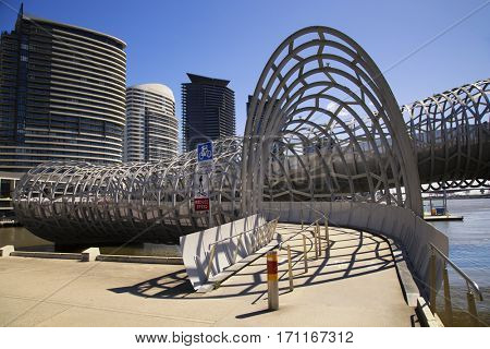 MELBOURNE, AUSTRALIA - OCT 19, 2016: The Webb Bridge in Melbourne is a pedestrian/cycle bridge over the Yarra River and a part of a public art project in Docklands area. Collaboration with Robert Owen