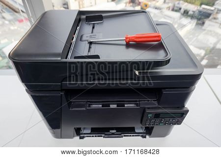 place red screwdriver on the printer plate for repair