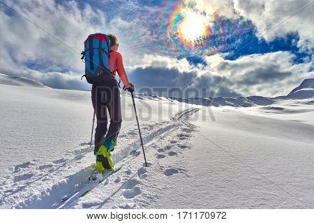 Girl Makes Ski Mountaineering Alone Toward The Mountain Pass