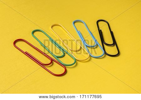 Close up of big bright multicolored paper clips with copy space for text.