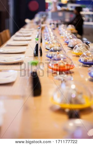 Various sushi arranged on table in restaurant of supermarket