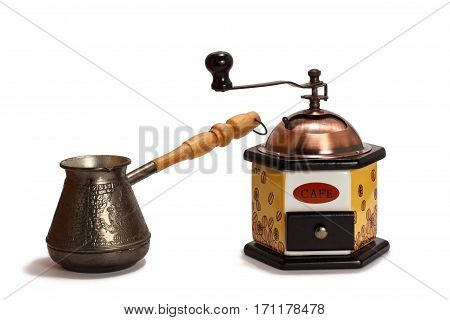 Coffee grinder with cezve on white isolated background