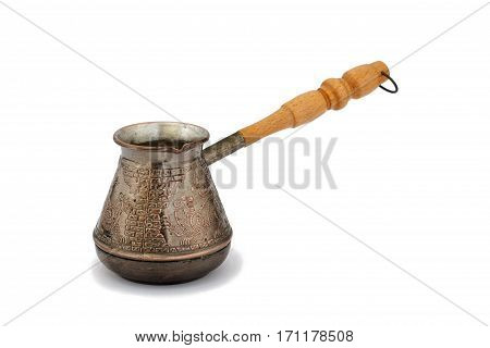 Copper cezve with wooden handle on white isolated background