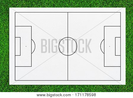 Abstract soccer field or football field background for create soccer tactic and writing a soccer game strategy. With white paper background on green grass.