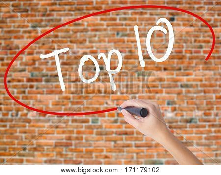 Woman Hand Writing Top 10 With Black Marker On Visual Screen