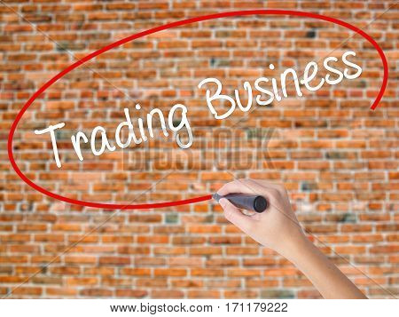 Woman Hand Writing Trading Business With Black Marker On Visual Screen.