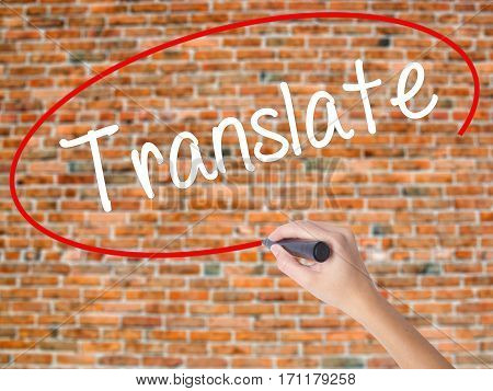 Woman Hand Writing Translate With Black Marker On Visual Screen