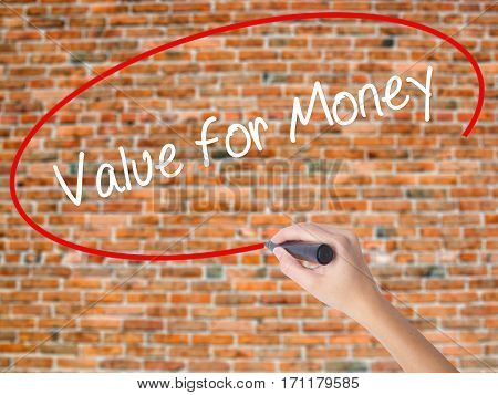 Woman Hand Writing Value For Money With Black Marker On Visual Screen