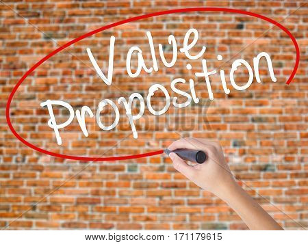 Woman Hand Writing Value Proposition With Black Marker On Visual Screen