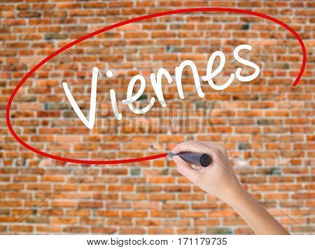 Woman Hand Writing Viernes (friday In Spanish) With Black Marker On Visual Screen