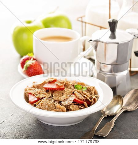 Multigrain wholewheat healthy cereals with fresh strawberryfor breakfast with copyspace