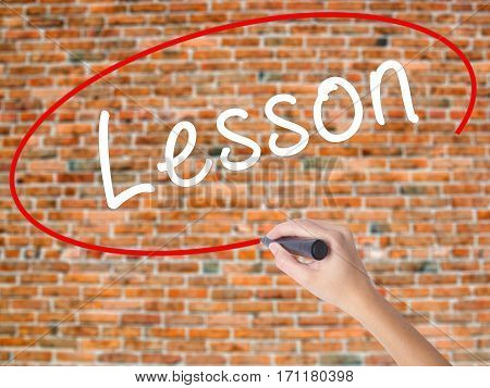 Woman Hand Writing Lesson With Black Marker On Visual Screen
