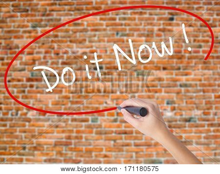 Woman Hand Writing Do It Now With Black Marker On Visual Screen