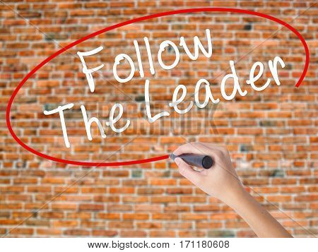 Woman Hand Writing Follow The Leader With Black Marker On Visual Screen